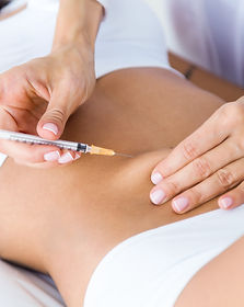 surgeon-making-injection-into-female-bod