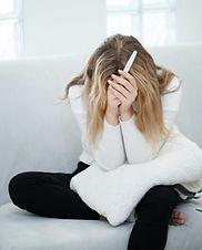 worried-sad-woman-looking-pregnancy-test