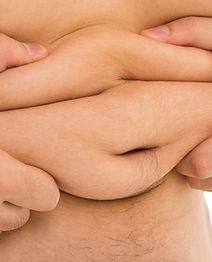 man-holds-his-fat-tummy.jpg