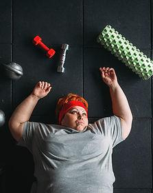 tired-fat-woman-lies-floor-gym-calories-