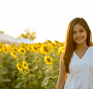 young-happy-asian-woman-smiling-in-the-f
