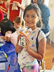 Family Vs Girl holding package note.jpg