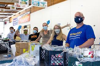 Eve and Pete with volunteers sorting foo