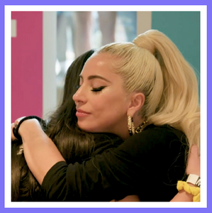 Lady Gaga hugging a fan