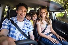 family in tinted car driving in Santa Rosa, CA