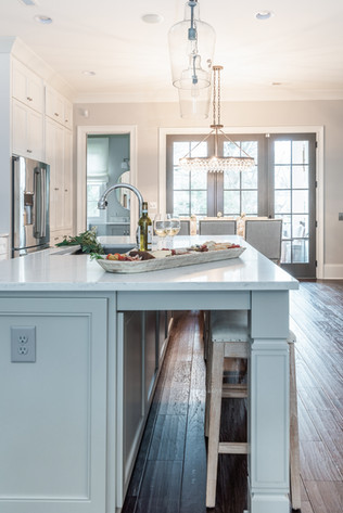 Sophisticated Town Home Kitchen Island Nested barstools