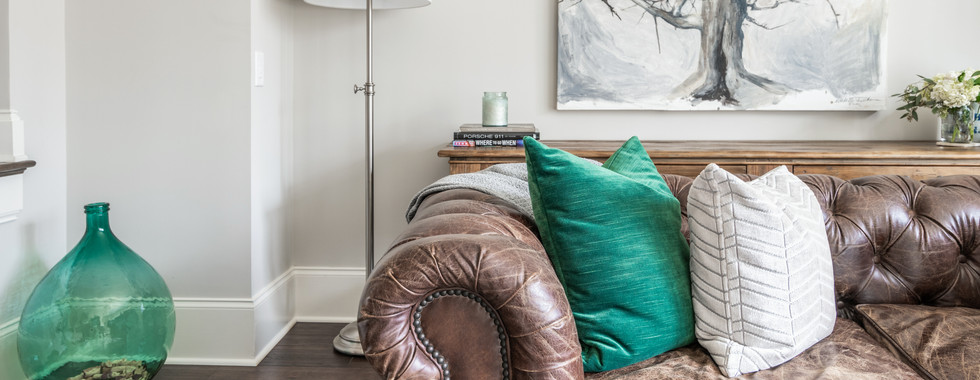 Sophisticated Town Home Living Room worn leather sofa