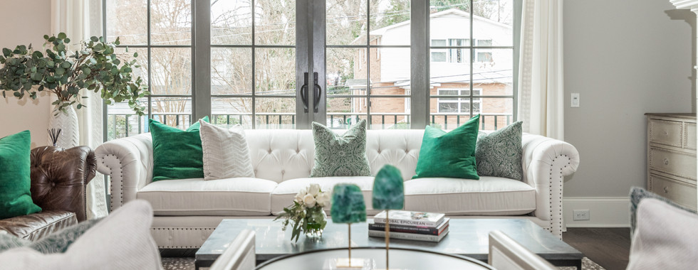Sophisticated Town Home Living Room Seating White Couch and coffee table