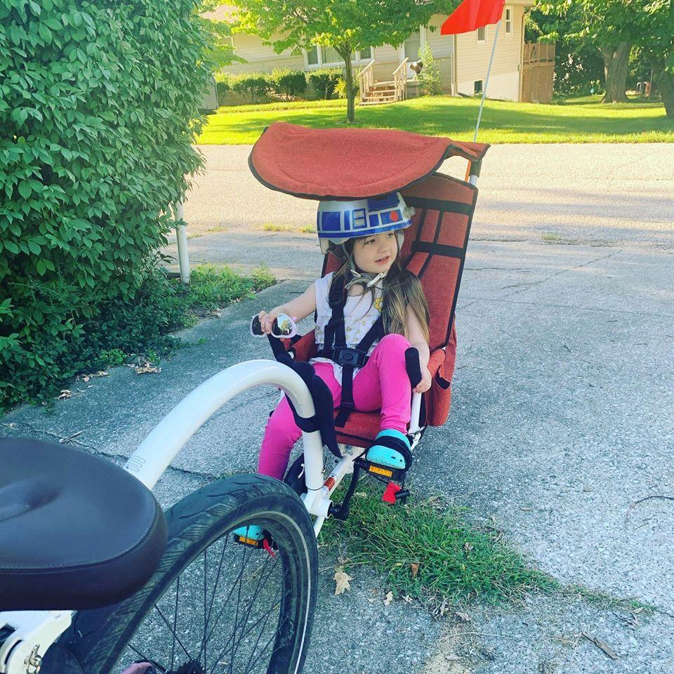 toddler in a weehoo bike trailer.