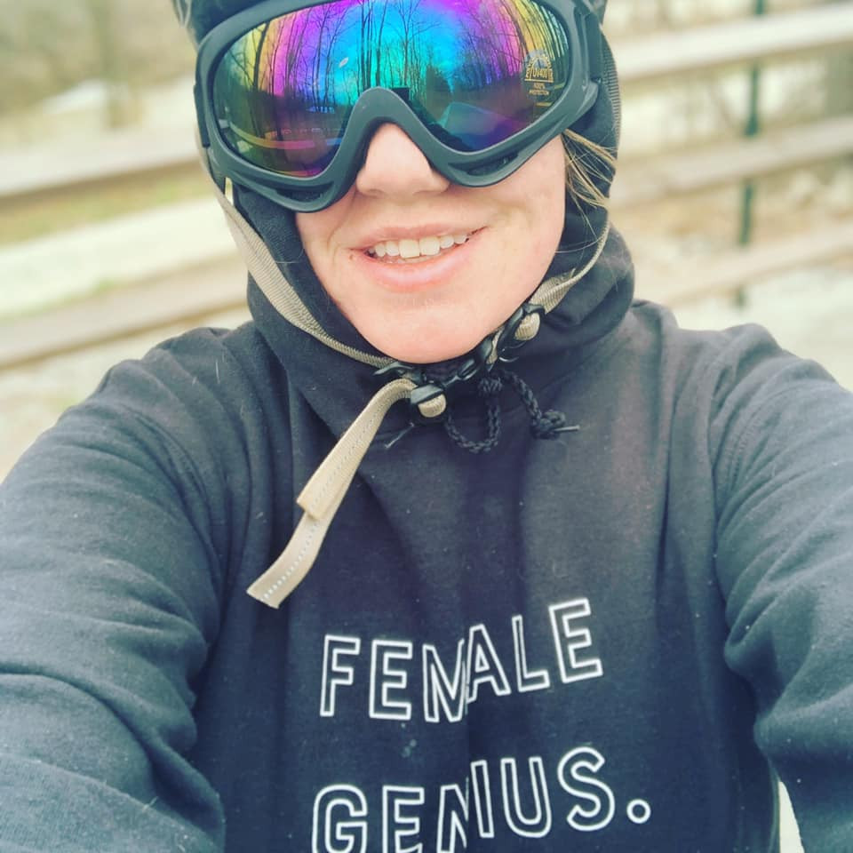 cyclist with ski goggles in a female genius hoodie