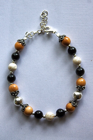 Bracelet with olive wood, silver, marble (Brach stone) and black corals