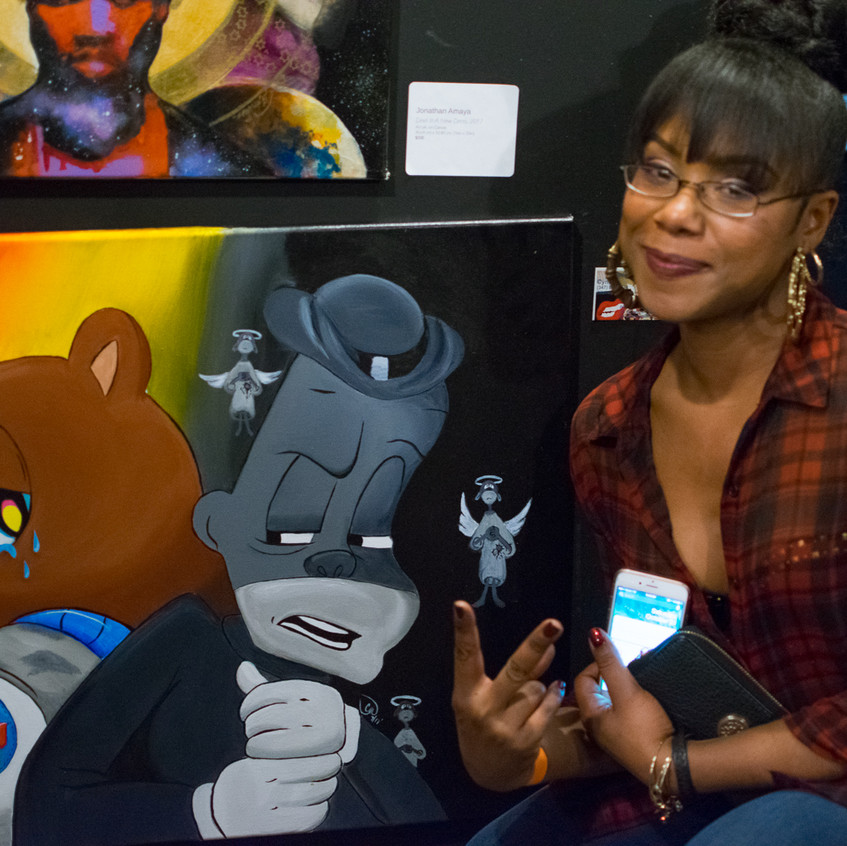 Artist posing with her work.