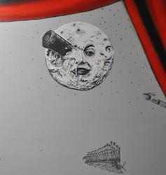 La lune est extrait d'un film intitulé 'Le voyage dans la Lune' réalisé par George Méliès en 1902, inspiré entre autre du roman 'De la Terre à la Lune'.