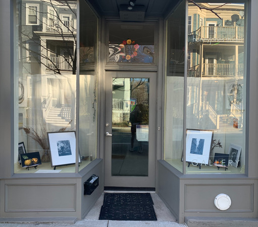 black and white and a bit of color photography in the windows, last few days of the showing