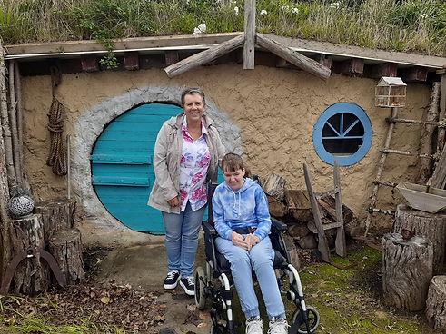 Teagan and Kylie hobbit house.jpg