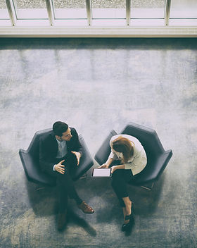 Looking down on a business Meeting between man and woman
