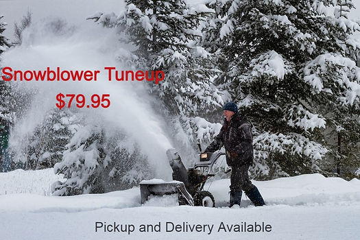 man-using-snowblower-in-winter-storm-507