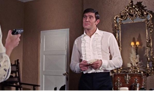 George Lazenby wears frills
