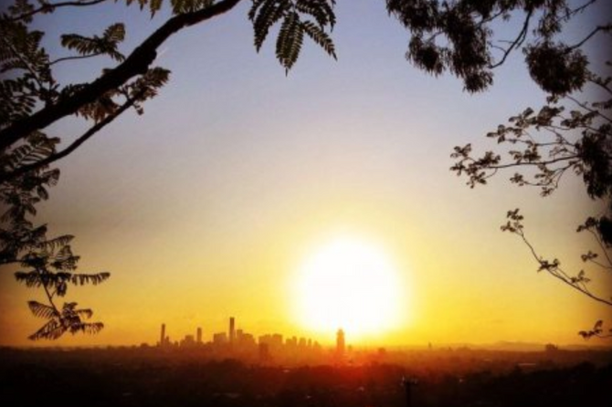 Temperature rises will make Brisbane a 'difficult place to live' within 30 years, report fin