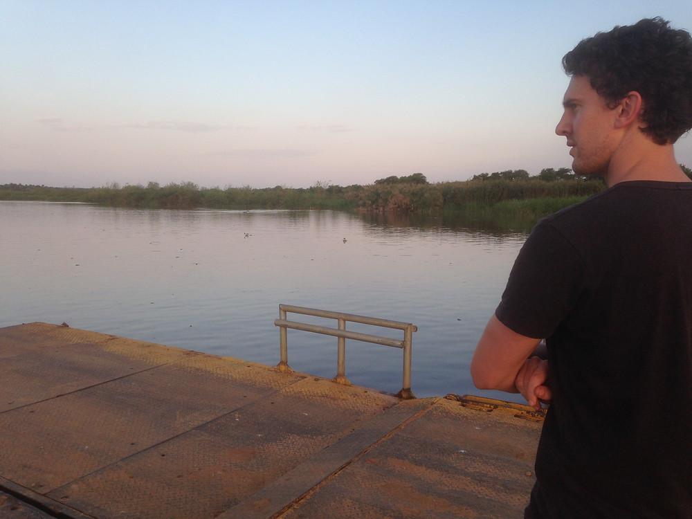 James Allan awaiting the barge to take him across the Victoria Nile