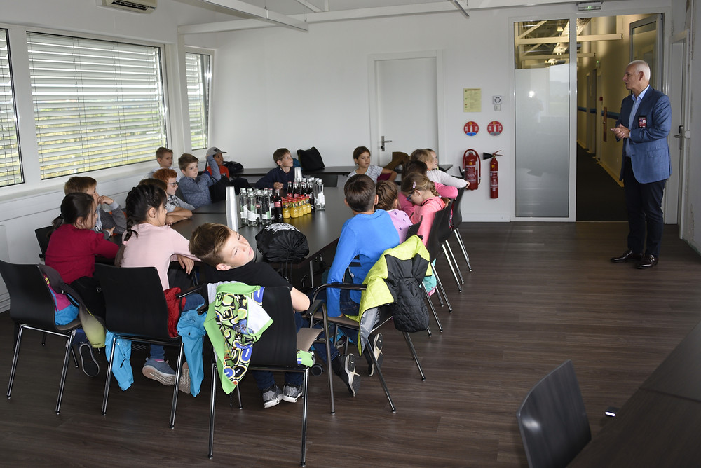 Children in the Air Service Basel offices with CEO Claudio Lasagni