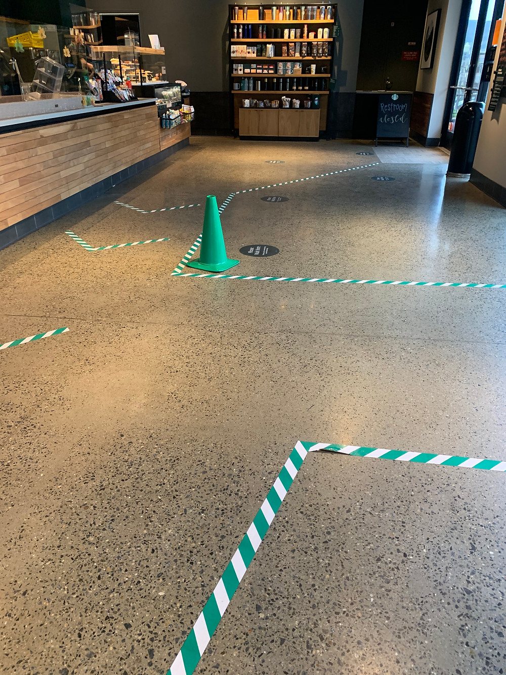 Empty Starbucks store with cones and lines