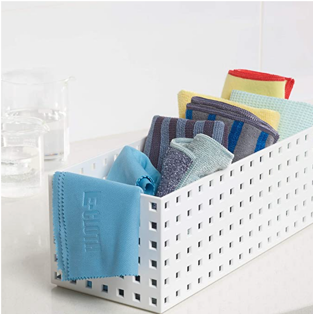 white bin of cleaning cloths