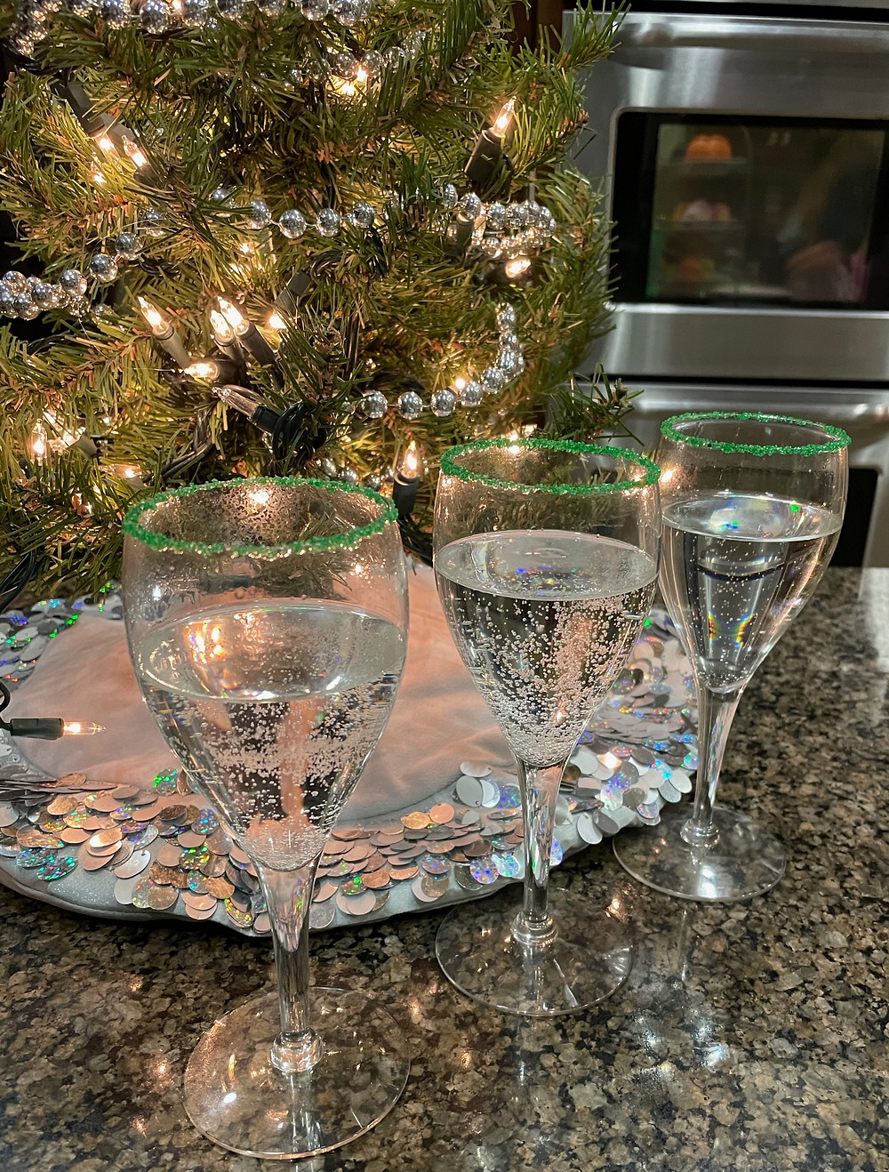 Grinch Juice in green sugar rimmed wine glasses