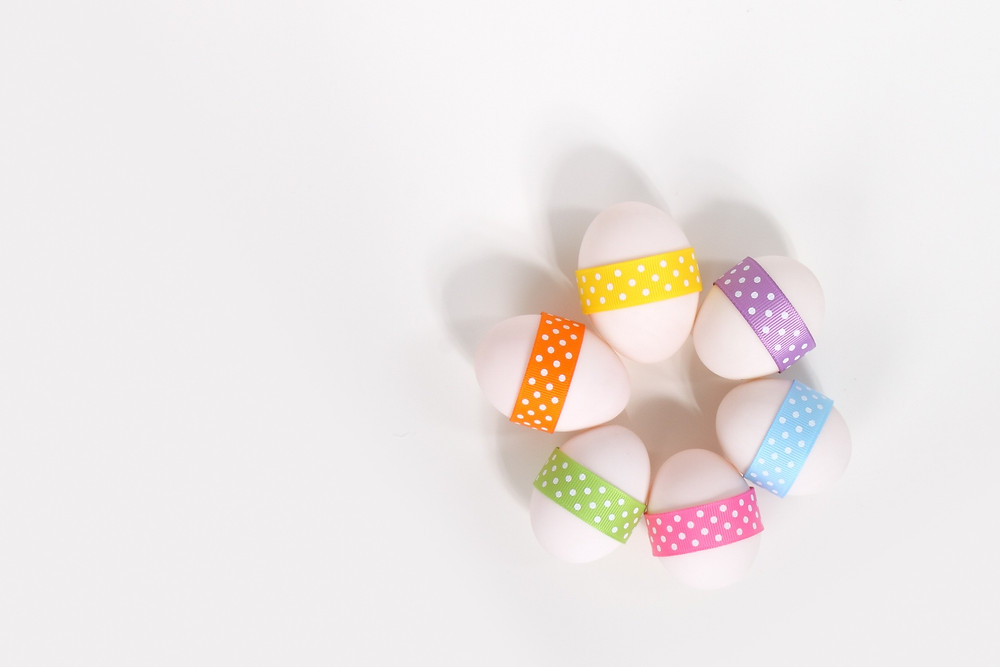 Easter eggs decorated with multi-colored ribbon