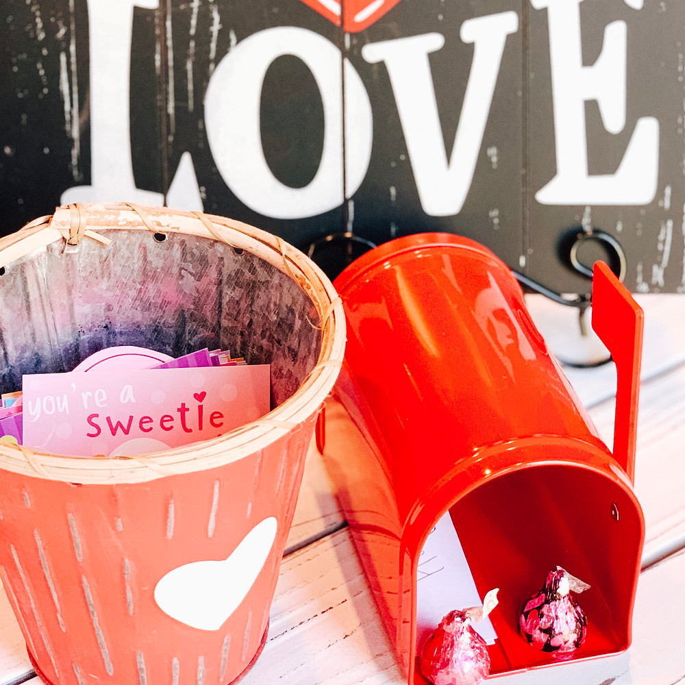 Love sign with red mailbox and valentine container