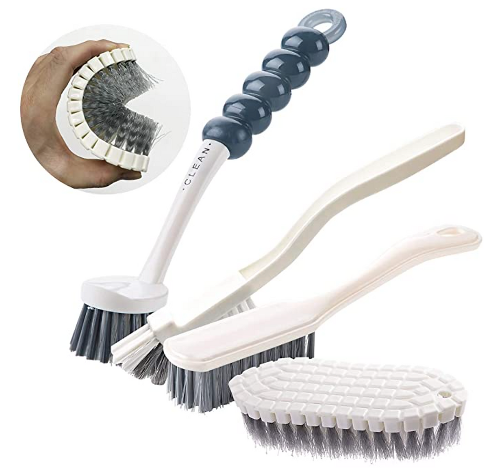 Set of white cleaning brushes