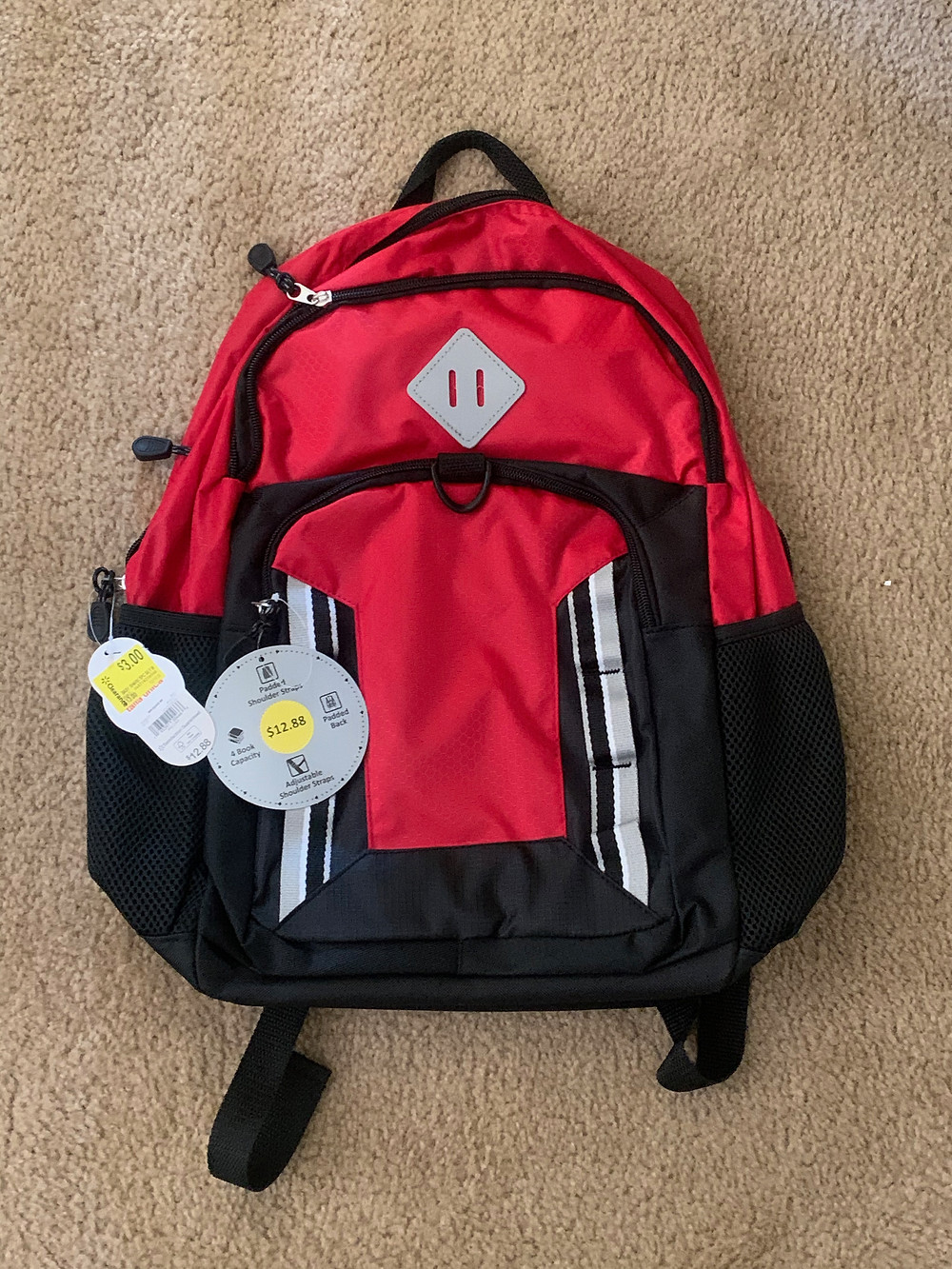 New red school backpack with tags
