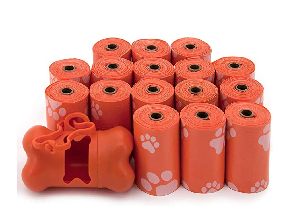 Orange dog waste poop bags and dispenser