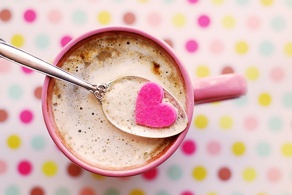Coffee cup with spoon and heart candy