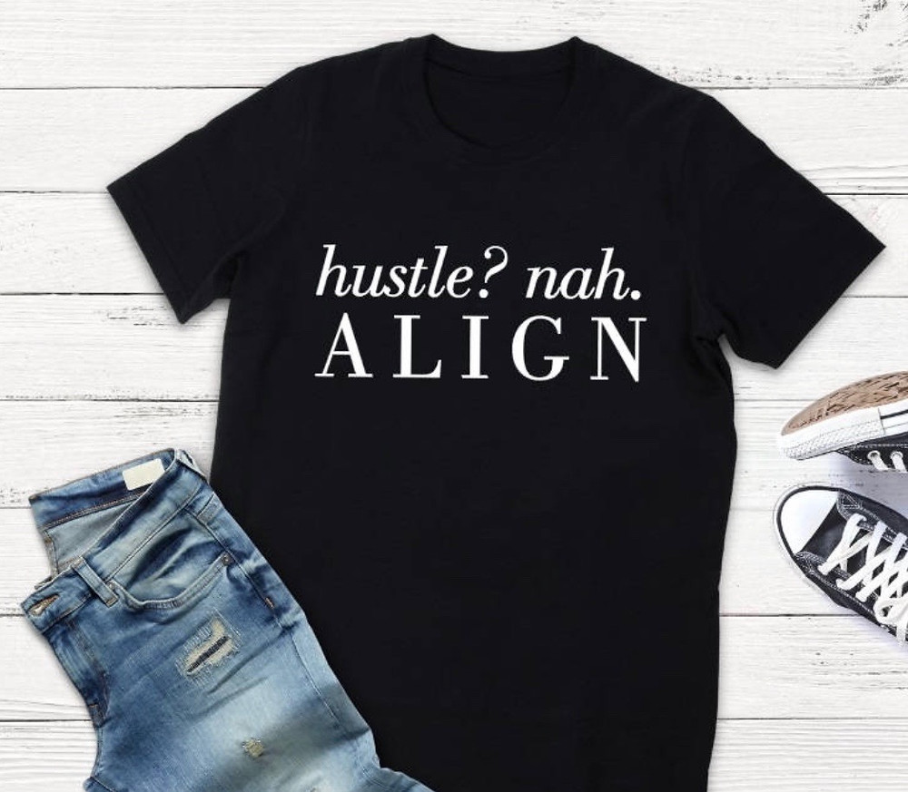 Black t-shirt with align quote with jeans and tennis shoes
