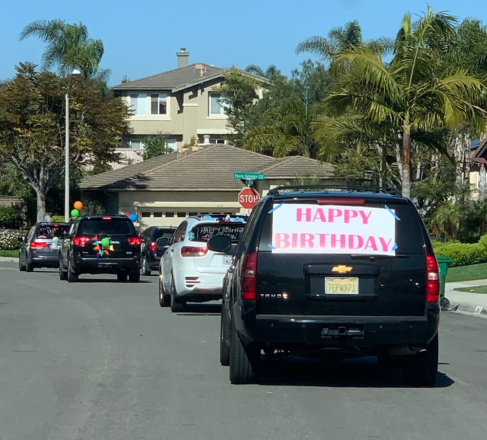 Caravan of cars for birthday parade