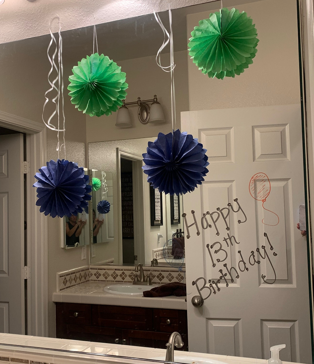 Dry Erase Birthday Sign and Decorations on Bathroom Mirror