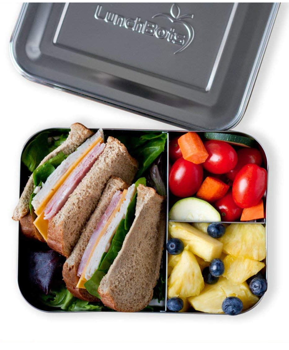 Metal eco-friendly lunch box filled with healthy food