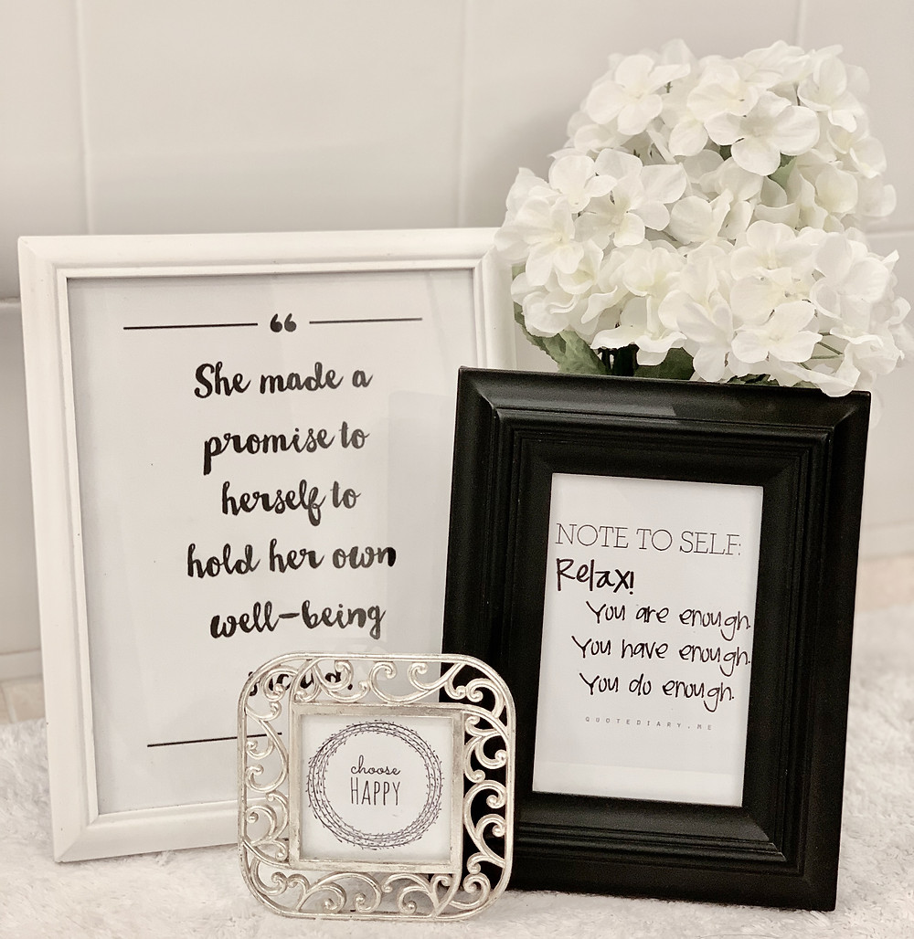 Framed inspirational quotes with white flowers
