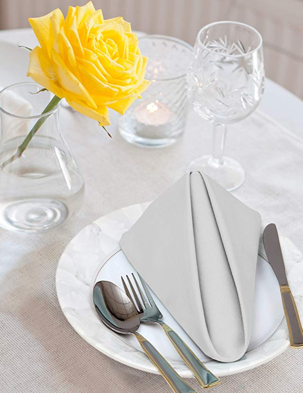 Place setting at a table with a nicely folded napkin