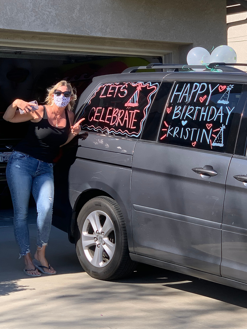 Mom with a minivan decorated for a birthday