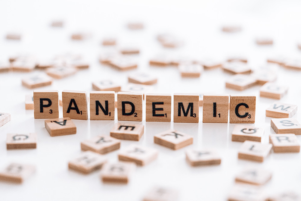 "The word ""Pandemic"" spelled in Scrabble tiles"