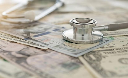stethoscope-money-gettyimages-651143122-