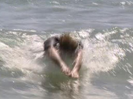 Body surf a broken wave