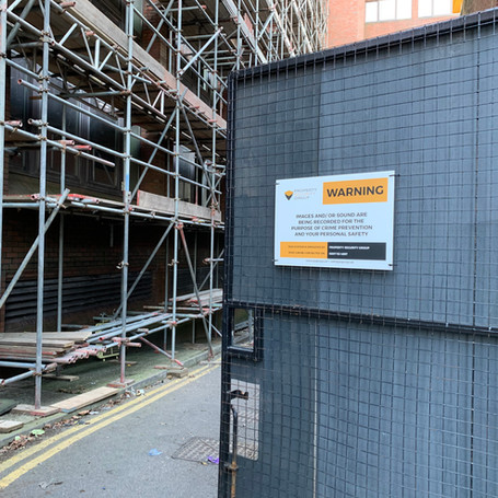 Scaffolding alarms with security cameras for live monitoring