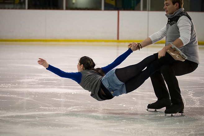 Two skaters, one in a lift