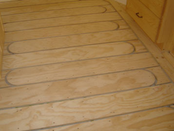 Plywood sleepers, ready for tubing in kitchen remodel. Barefoot Radiant Heating.