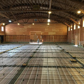 Tubing for slab of shoe factory in old skating rink. Barefoot Radiant Heating.