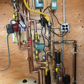 Boiler piping and controls for shoe factory. Barefoot Radiant Heating.