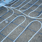 Close-up of tubing tied to rebar.  Barefoot Radiant Heating.